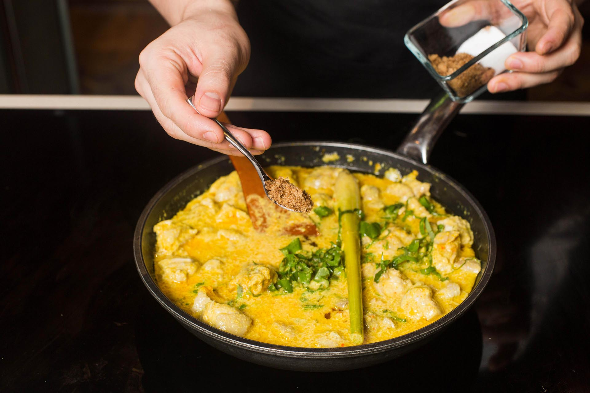 Season the curry and add turmeric leaves