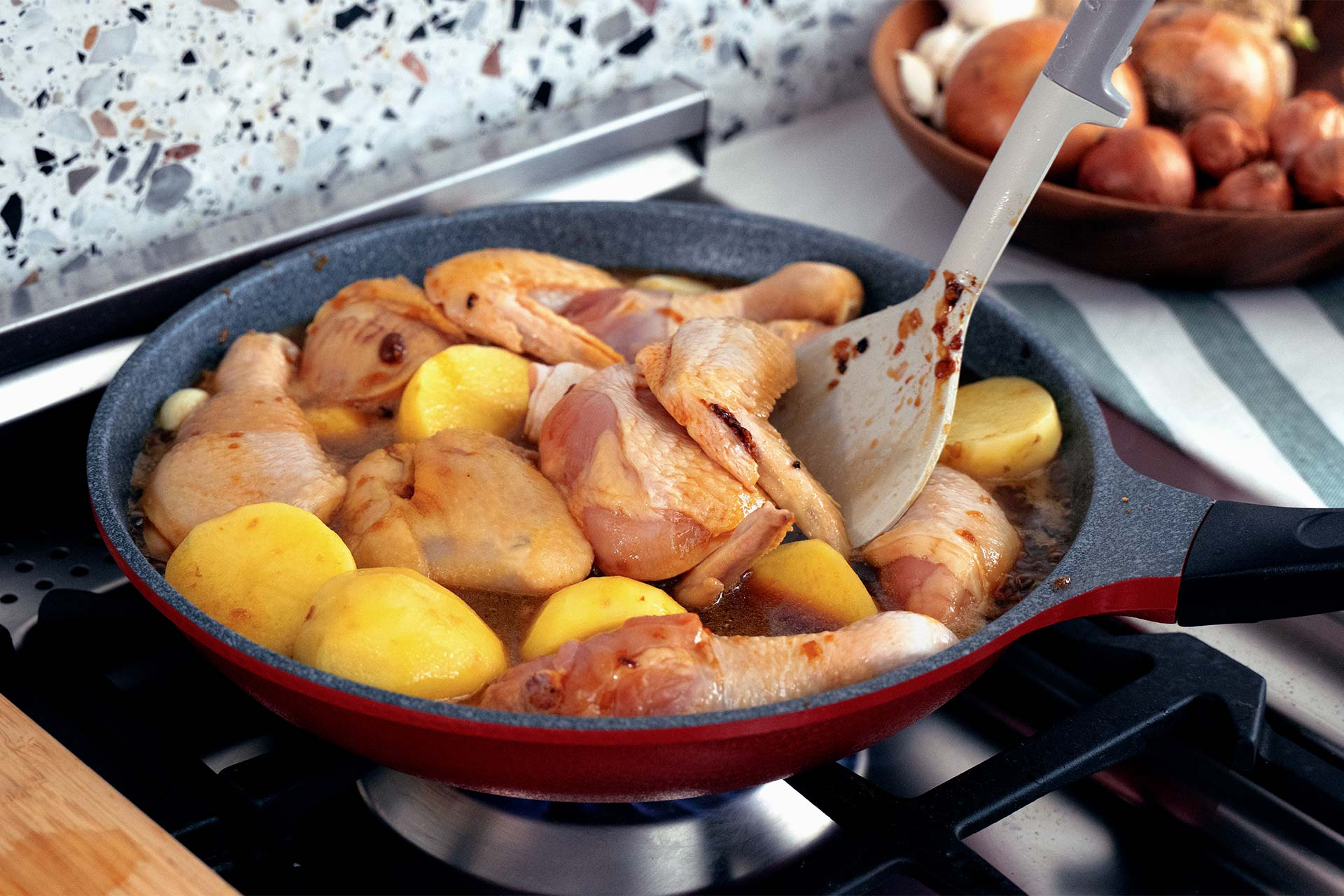 Add chicken, potatoes, dark soy sauce and water