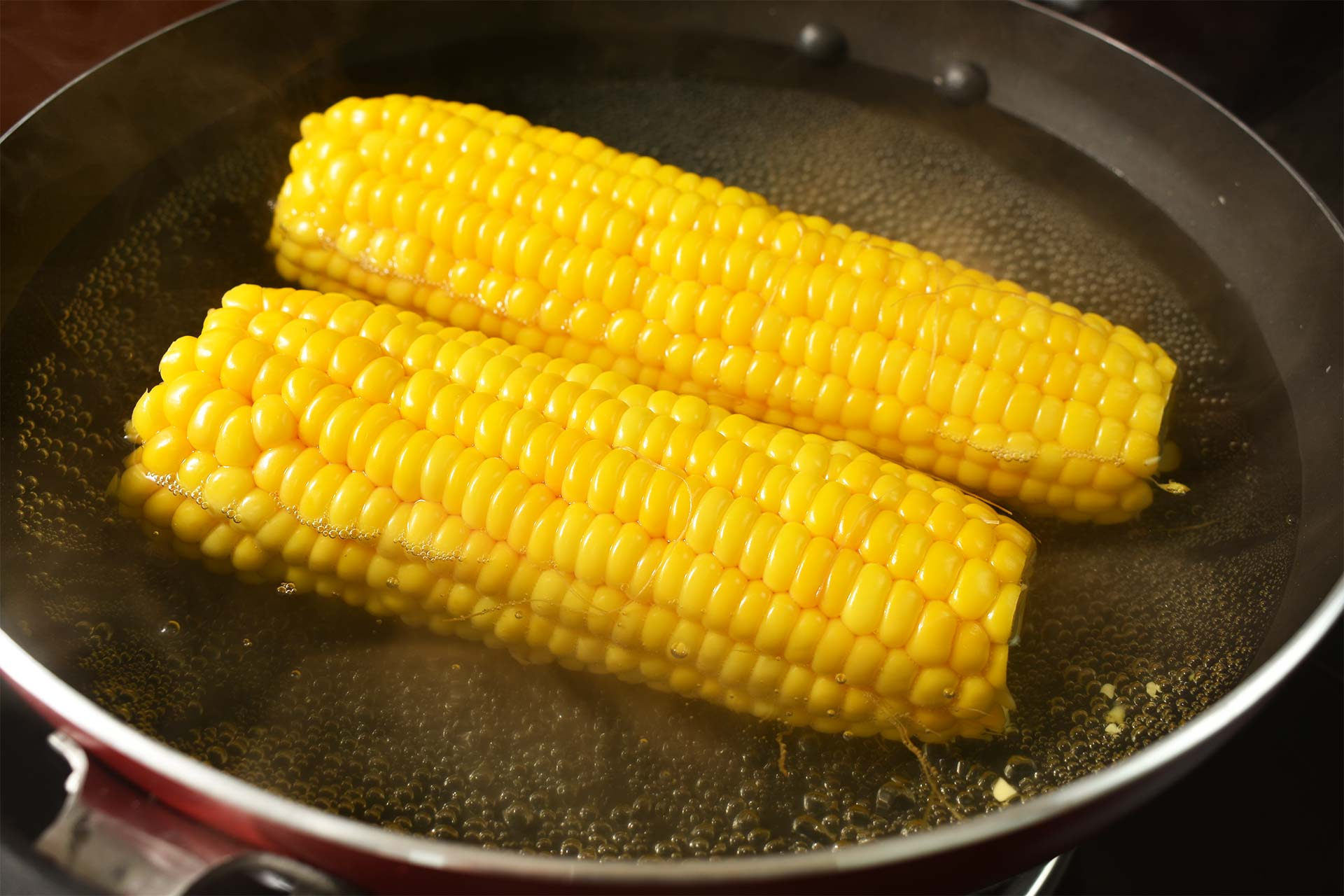Prepare and par-cook the corn