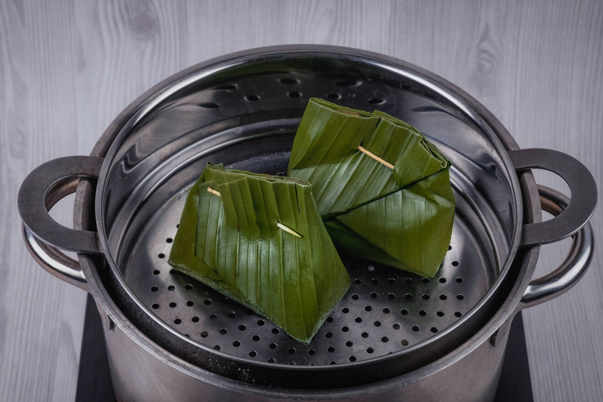 Wrap mixture with banana leaves