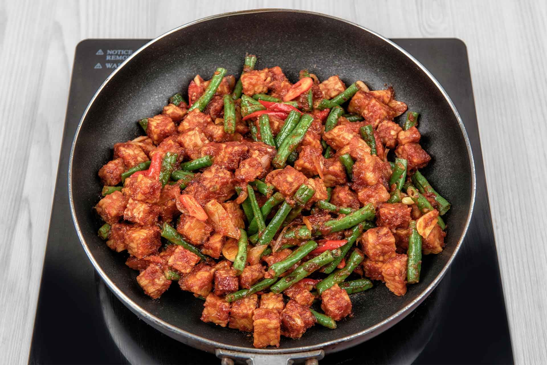 Making Sauteed Tempeh with Spicy Long Bean