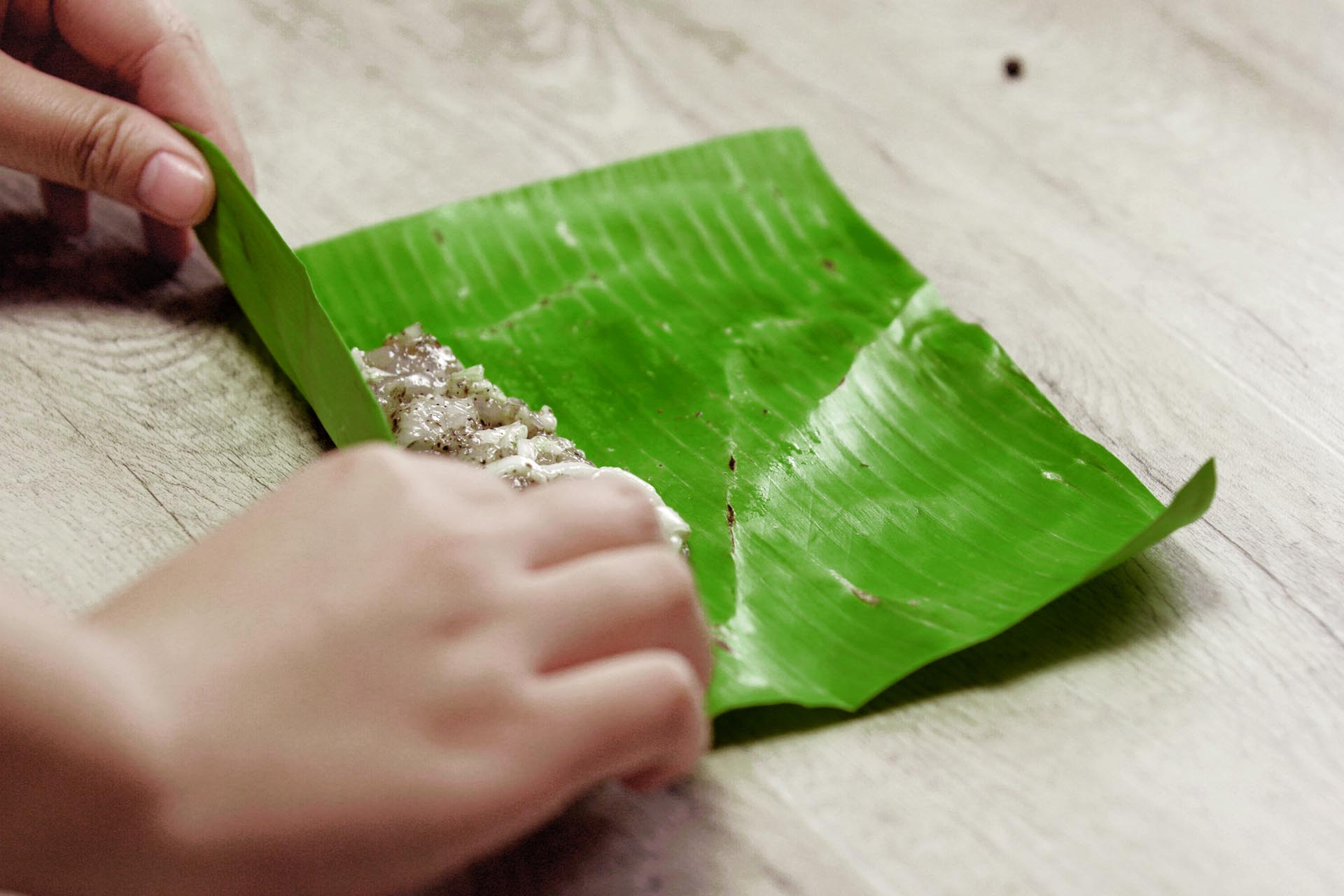 Wrap filling in banana leaf