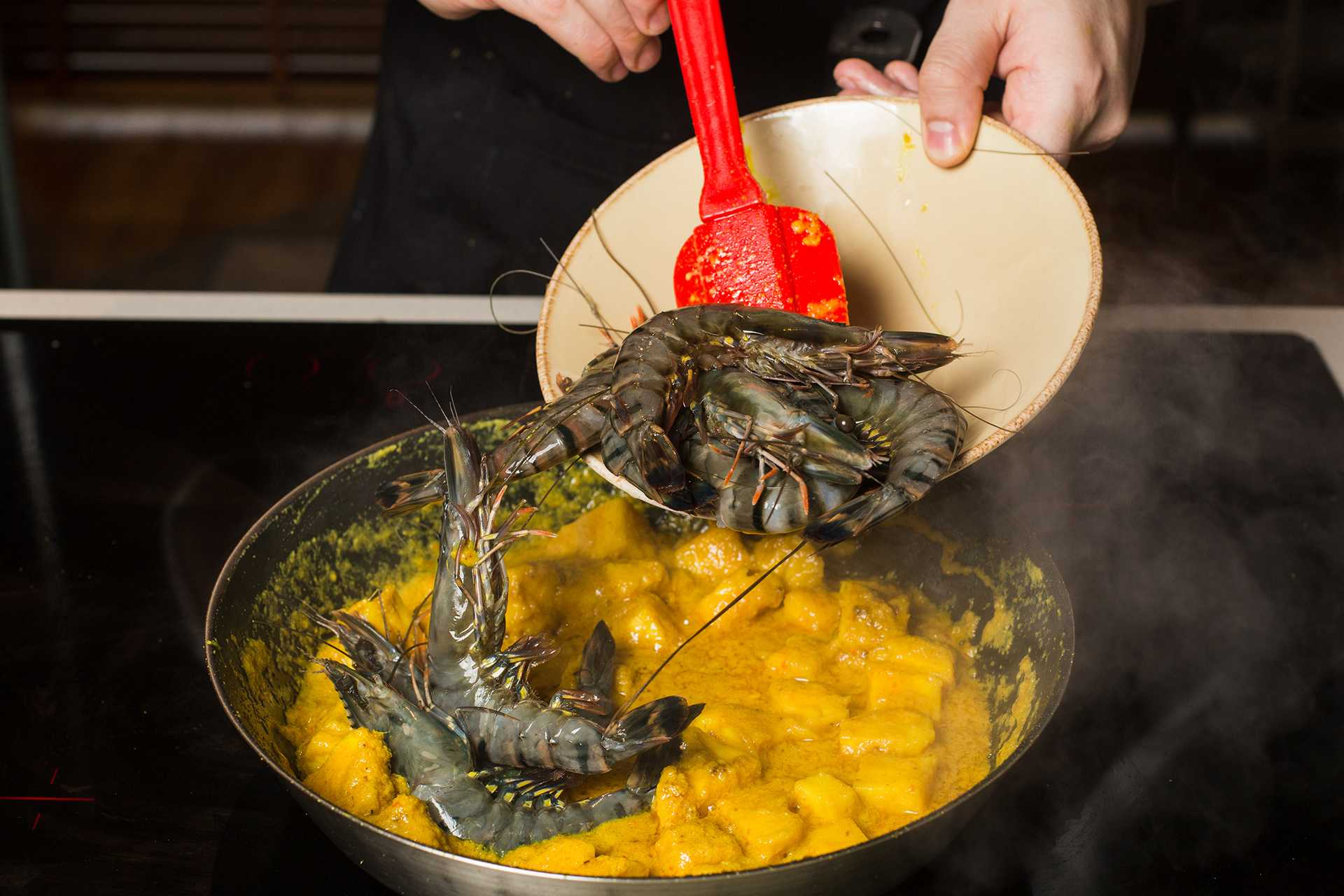Cook the prawns and season